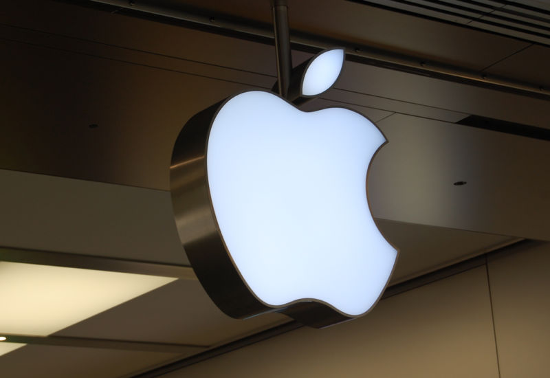 The Apple logo takes corporeal form outside an Apple store.