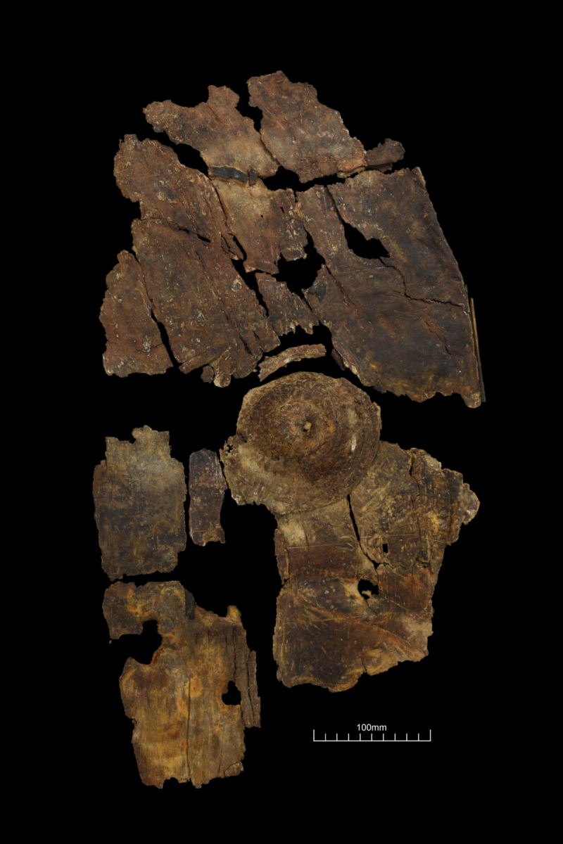 Photo of ancient shield in pieces.